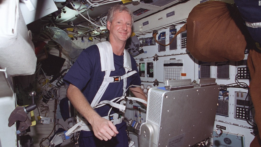 Astronaut Steven A. Hawley runs on a treadmill on the middeck of the Space Shuttle Columbia in 1999.