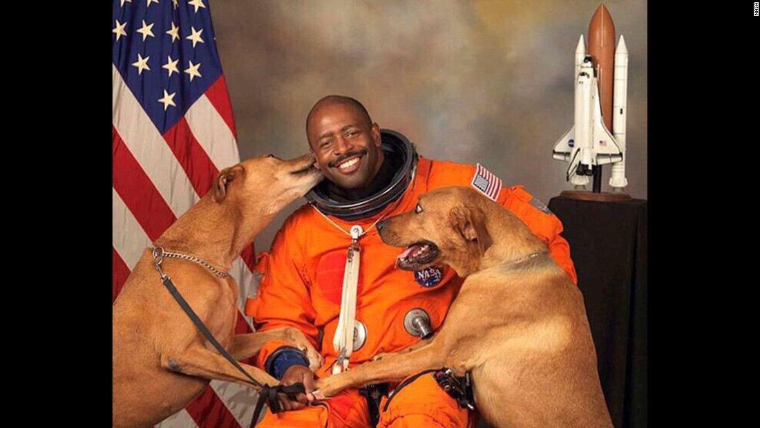 Astronaut Leland Melvin included his dogs, Jake and Scout, in his official NASA photo. Posted on Twitter in early February, it was retweeted thousands of times.