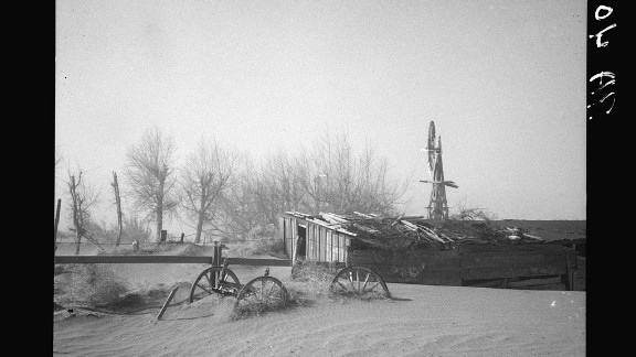 The Dust Bowl drought in the 1930s: Dust blows up dunes at Oklahoma farm.