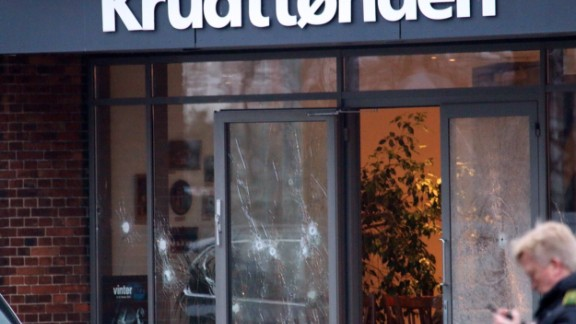 Bullet holes can be seen in the doors of the venue that housed the event. The attackers made it into the lobby but apparently got no farther, according to journalist in attendance.