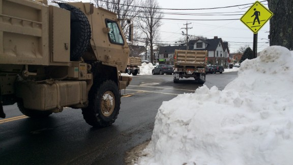 Trucks from the U.S. Army National Guard roll into Rockport, Massachusetts, on Saturday, February 14, ahead of the predicted blizzard to assist with snow removal.