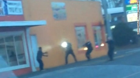 In an frame taken from a YouTube video posted by Dario Zuniga, Antonio Zambrano-Montes, 35, (far left) is seen immediately before he was fatally shot by Pasco, Washington, police officers who confronted him (three, to the right).
