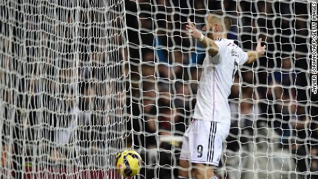 Karim Benzema celebrates after scoring during the Spanish league football match betweeen Real Madrid and Deportivo de la Coruna.