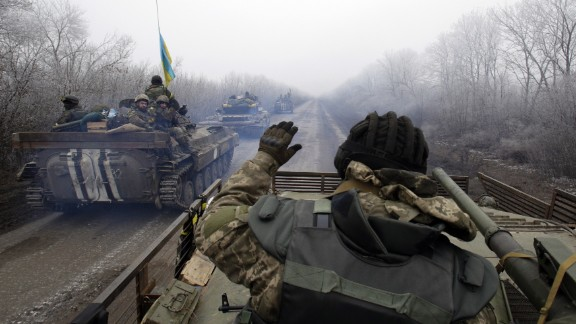 A convoy carrying Ukrainian forces drives to Debaltseve, Ukraine, on February 14.