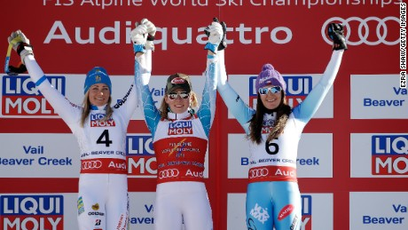 Mikaela Shiffrin of the U.S. (center) celebrates after claiming gold at the 2015 Alpine World Ski Championships.