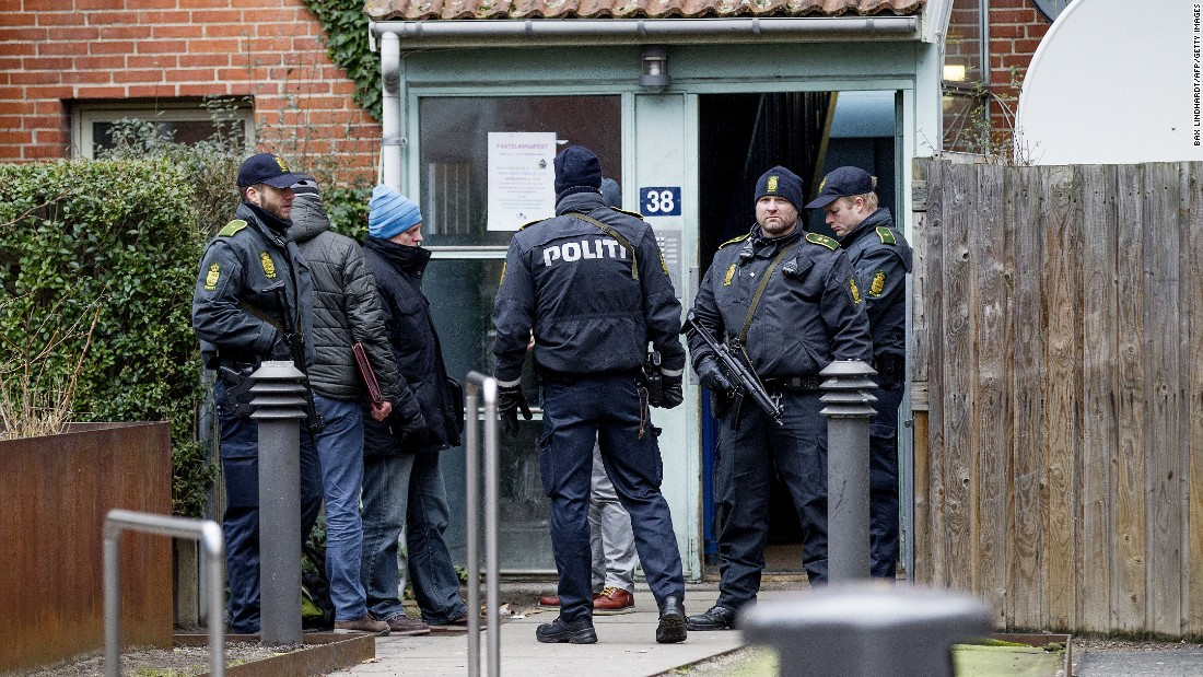 Danish police search an apartment in Copenhagen on February 15.
