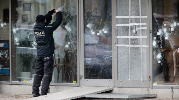 A police investigator works on February 15 at the scene of Saturday's shooting at a free speech event in Copenhagen.