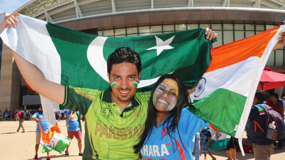 Pakistan and India cricket supporters pose with their flags outside of the Adelaide Oval.