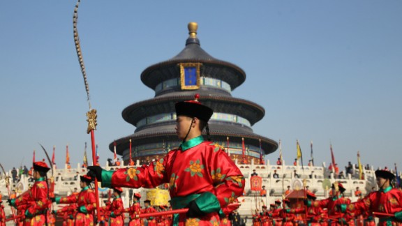 Chinese performers re-enact a traditional Qing Dynasty ceremony on Saturday, February 14, in which emperors prayed for good fortune at the Temple of Heaven in Beijing.