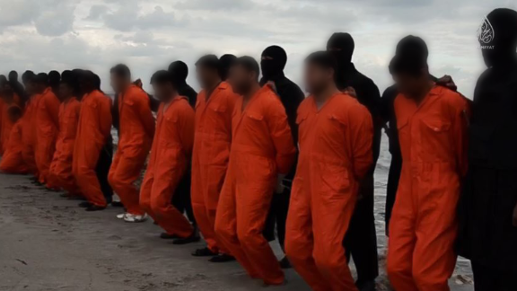In a new propaganda video released Sunday, February 15 by ISIS, the group claims to have beheaded over a dozen members of Egypt's Coptic Christian minority on a Libyan beach. The release shows a mass execution with jihadists in black standing behind each victim -- all are dressed in an orange jumpsuit and handcuffed with zip ties.