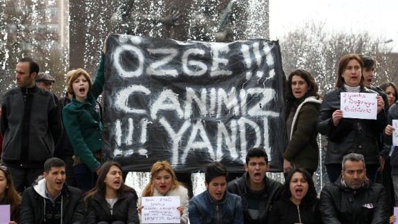 Protesters hold a banner reading 'Ozge, we have suffered with you' during a demonstration in Ankara.