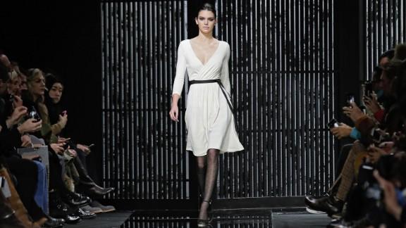 Kendall Jenner walks the runway in an iconic Diane von Furstenberg wrap dress.