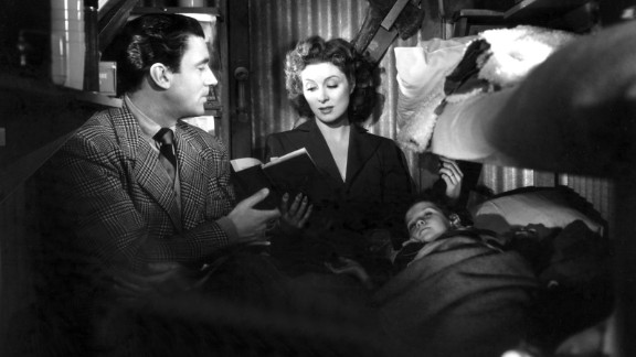 """""""Mrs. Miniver"""" (1943): Hollywood's war effort went full throttle with William Wyler's """"Mrs. Miniver"""" starring Walter Pidgeon and Greer Garson as a heroic couple whose family endures German air raids during the Battle of Britain. Garson also won the best actress award and received much flak for a lengthy acceptance speech that became the stuff of Hollywood legend."""