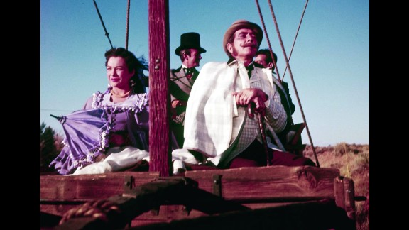 """""""Around the World in 80 Days"""" (1957): Responding to the competition from TV, the movies turned increasingly to epics in the 1950s such as producer Mike Todd's """"Around the World in 80 Days."""" The picture  was based on Jules Verne's novel and starred Shirley MacLaine, David Niven and Cantinflas as well as dozens of other celebrities in cameo roles, such as Noel Coward, Marlene Dietrich, Red Skelton and Frank Sinatra."""