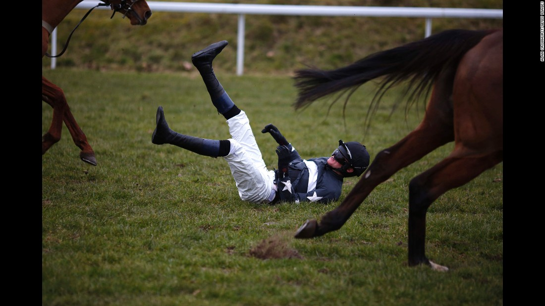 Jockey Conor Ring falls off his horse Wednesday, February 11, at Chepstow Racecourse in Chepstow, Wales.