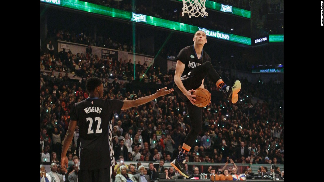 Zach LaVine takes the ball from Minnesota teammate Andrew Wiggins as he participates in the NBA's Slam Dunk Contest on Saturday, February 14. LaVine defeated Victor Oladipo in the final round of the event, which was held in New York as part of the league's All-Star Game festivities.