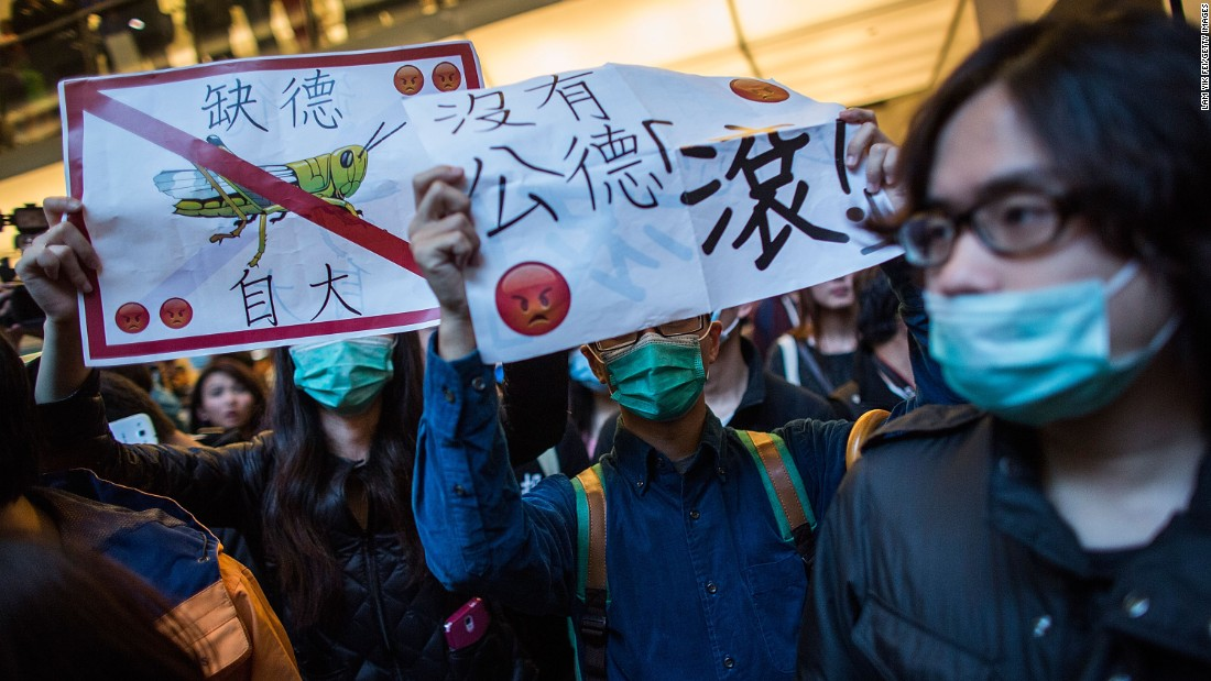 "Angry protesters refer to the Chinese parallel traders as ""locusts,"" a derogatory term. They complain that parallel traders drive up prices and impact their daily lives."