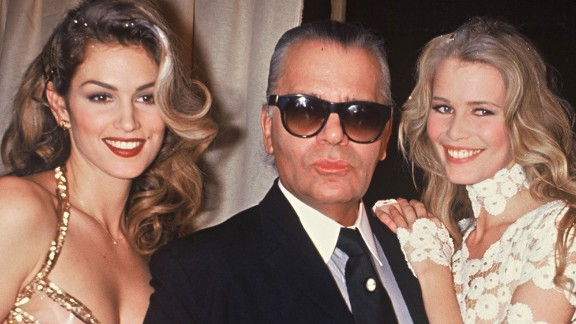 Crawford and supermodel Claudia Schiffer pose with fashion designer Karl Lagerfeld in Paris in 1993.
