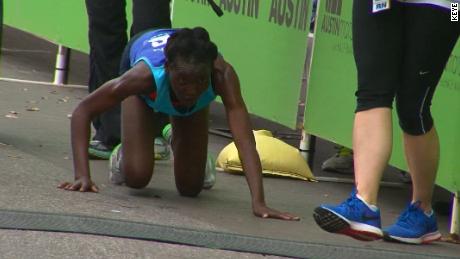 Elite Runner Crawls Across The Finish Line At Austin Marathon