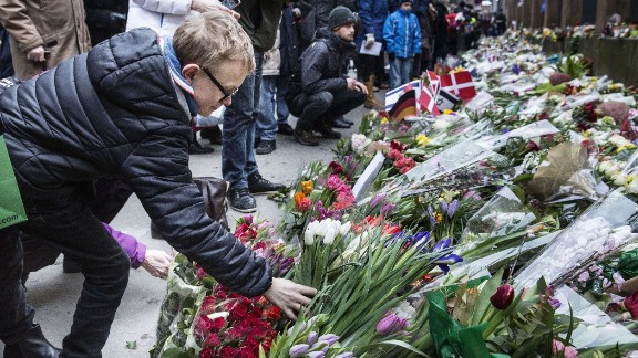 People put flowers to honour the shooting victims outside the main Synagogue of Copenhagen on February 16, 2015, after last week-end two fatal attacks. The attacks, which targeted a debate on Islam and free speech and a synagogue, came just a month after the Islamist attacks in Paris at satirical newspaper Charlie Hebdo office and a Kosher Supermarket.  AFP PHOTO / CLAUS BJOERN LARSENCLAUS BJOERN LARSEN/AFP/Getty Images