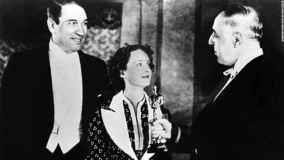 "Victor McLaglen, left, beat out two earlier Oscar winners to claim the best actor prize for ""The Informer."" He was up against Charles Laughton and Clark Gable, both nominated for their roles in best picture winner ""Mutiny on the Bounty."" McLaglen appears with best actress winner Bette Davis and filmmaker D.W. Griffith of ""The Birth of a Nation"" fame at the March 1936 ceremony."