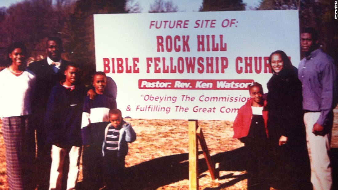 Benjamin Watson stands with family on the grounds of his father's future home for his Rock Hill, SC church.