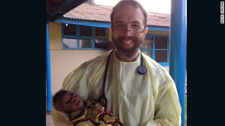 "Dr. Rick Sacra holds the baby ""Noah"" on the morning of his discharge."