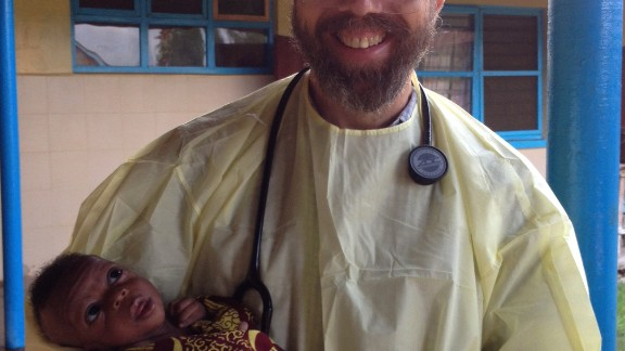 """Dr. Rick Sacra holds the baby """"Noah"""" on the morning of his discharge."""