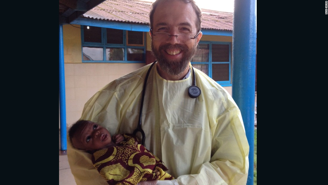 "Sacra holds a baby named Noah on the morning of his discharge. For the future, ""for the sake of the courageous doctors, nurses, lab technicians and aides who continue to face the same risk I faced, the global community needs to press forward with the task of improving protocols for preventing Ebola in hospitals, clinics and communities,"" Sacra said. ""We need to press on with generous funding for Ebola vaccine and treatment trials so that some good science backed up by data can inform our actions. We should be doing our best to enroll every health worker in Sierra Leone, Guinea and Liberia in a vaccine trial. And even when we get to zero cases of Ebola, we need to turn our attention to training thousands of doctors and nurses to form a stronger health-care work force for these nations, so they will be ready to quickly contain the next outbreak of Ebola or other highly infectious disease."" That, he argues, is essential. ""If we think about it, we'll realize that we can't afford to do otherwise."""