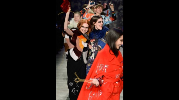 Libertine creative director Johnson Hartig encouraged models on their final walk to be as festive as his graphic fall collection.