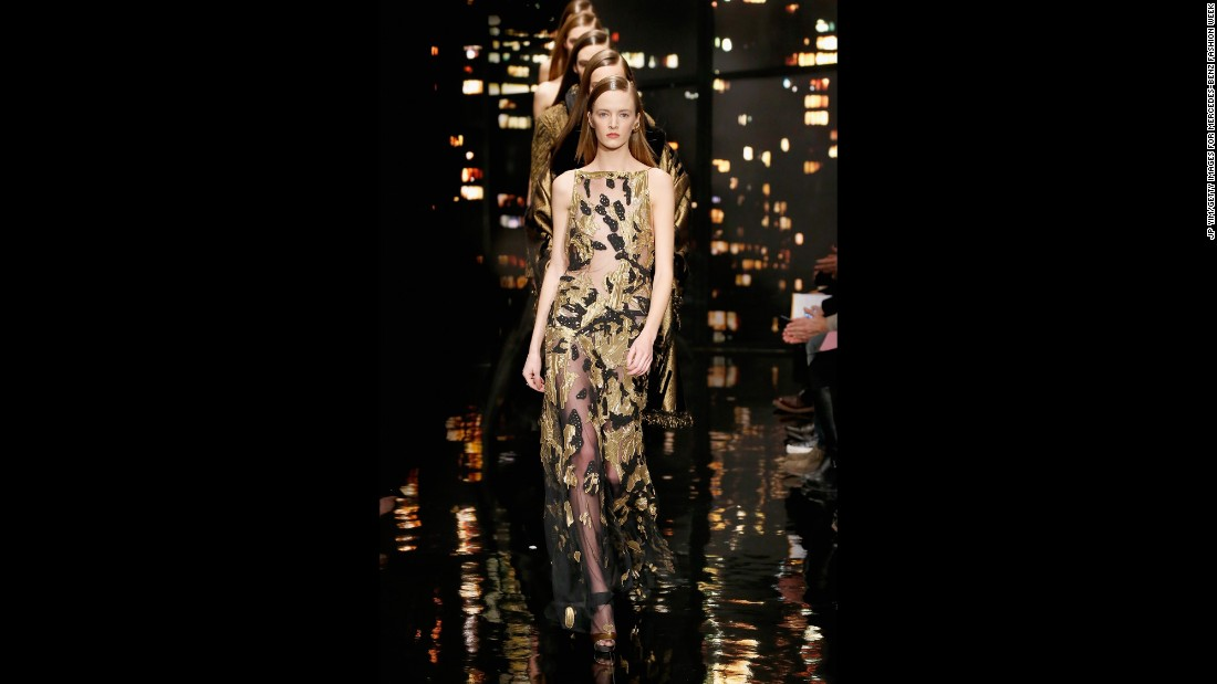 Donna Karan played with sheer panels in this gold and black evening dress.