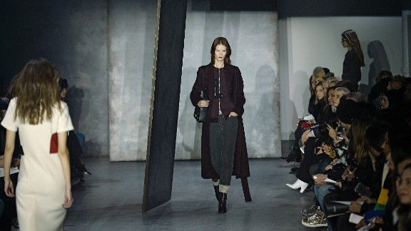 A model walks in street-smart layers for 3.1 Phillip Lim.
