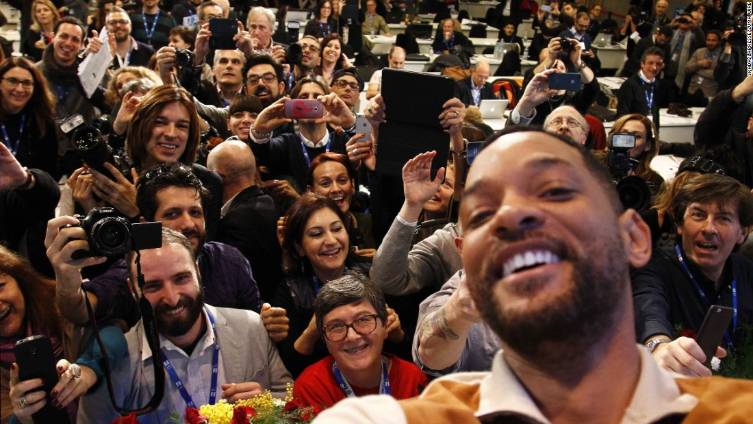 "Actor Will Smith turns the camera on the media (and himself) during a press conference in Sanremo, Italy, on Saturday, February 14. Smith was promoting his new movie ""Focus."""