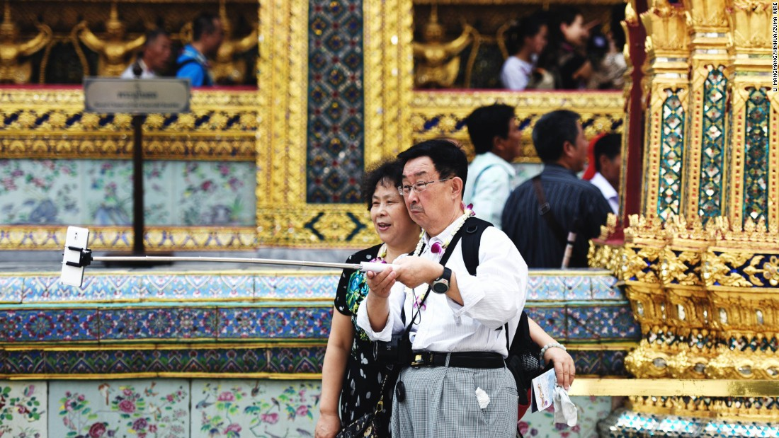 A couple takes a selfie at the Grand Palace in Bangkok, Thailand, on Sunday, February 15.