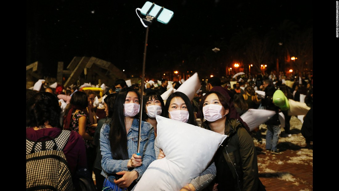 People take a selfie during the Great San Francisco Pillow Fight, an annual Valentine's Day tradition. Participants are encouraged to wear masks so they don't inhale feathers.