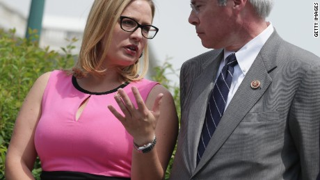 Then-Rep. Kyrsten Sinema and Rep. John Barrow, at left, are seen outside the U.S. Capitol in May 2014 in Washington, DC.