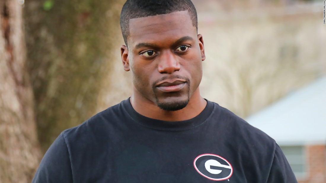 Benjamin Watson poses for the camera wearing one of his University of Georgia's T-Shirt (Feb. 5, 2014).