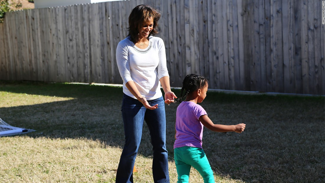 Benjamin Watson's wife outside playing with their daughter Naomi (Feb. 5, 2015).