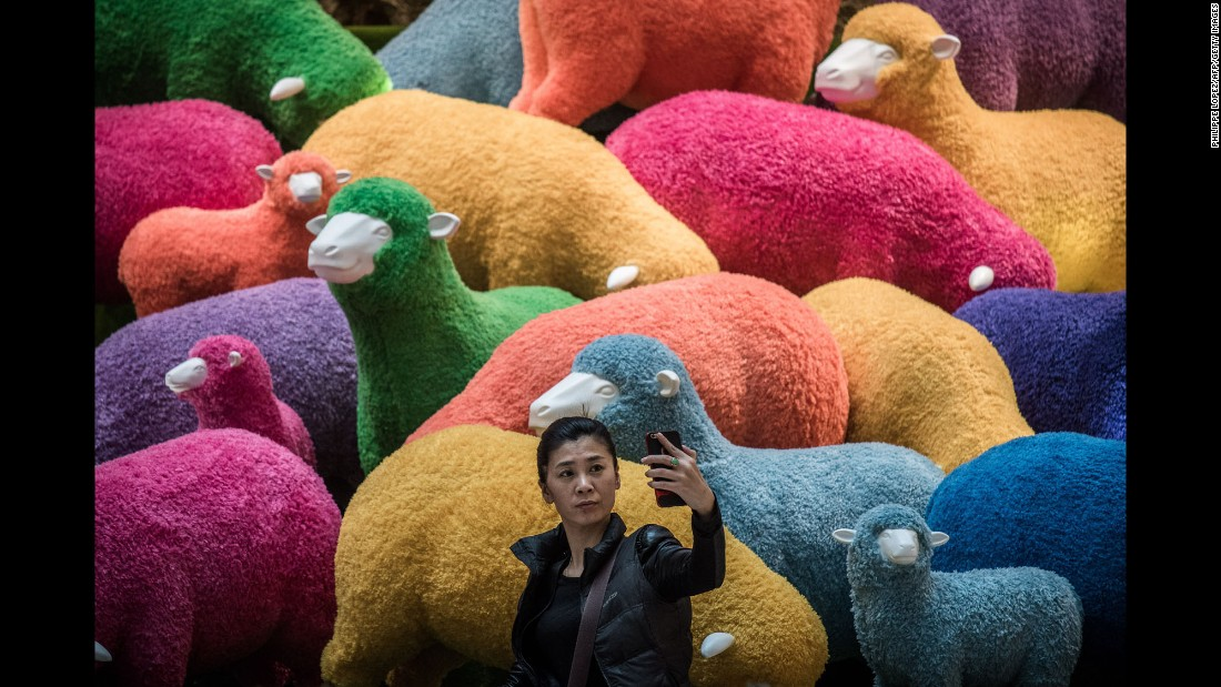 A woman takes a selfie in front of an art installation set up for Lunar New Year celebrations in a Hong Kong shopping mall on February 18.