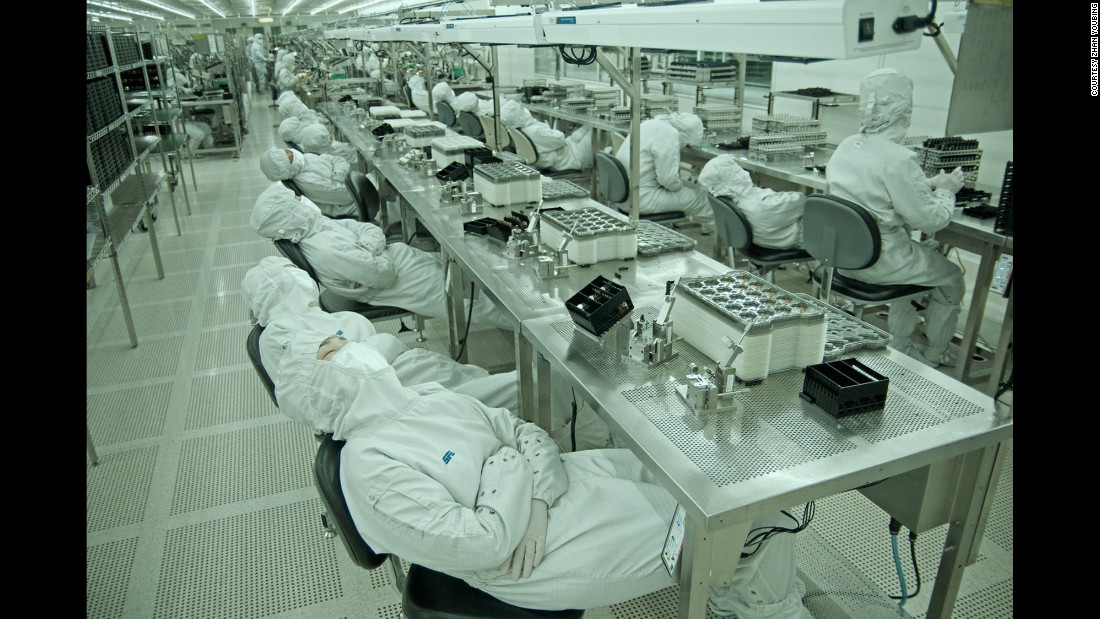 Workers take a nap on the assembly line.  They can take a 10-minute break each day.