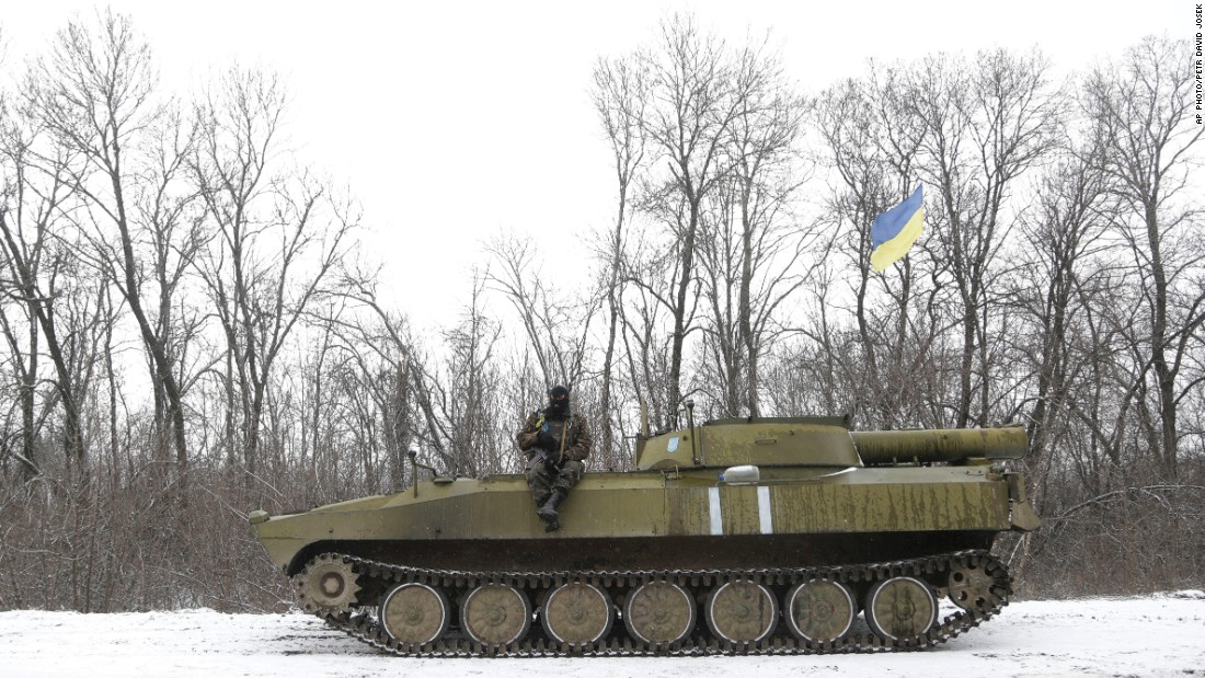 A Ukrainian soldier rests on his vehicle near the road between the towns of Debaltseve and Artemivsk on February 16.