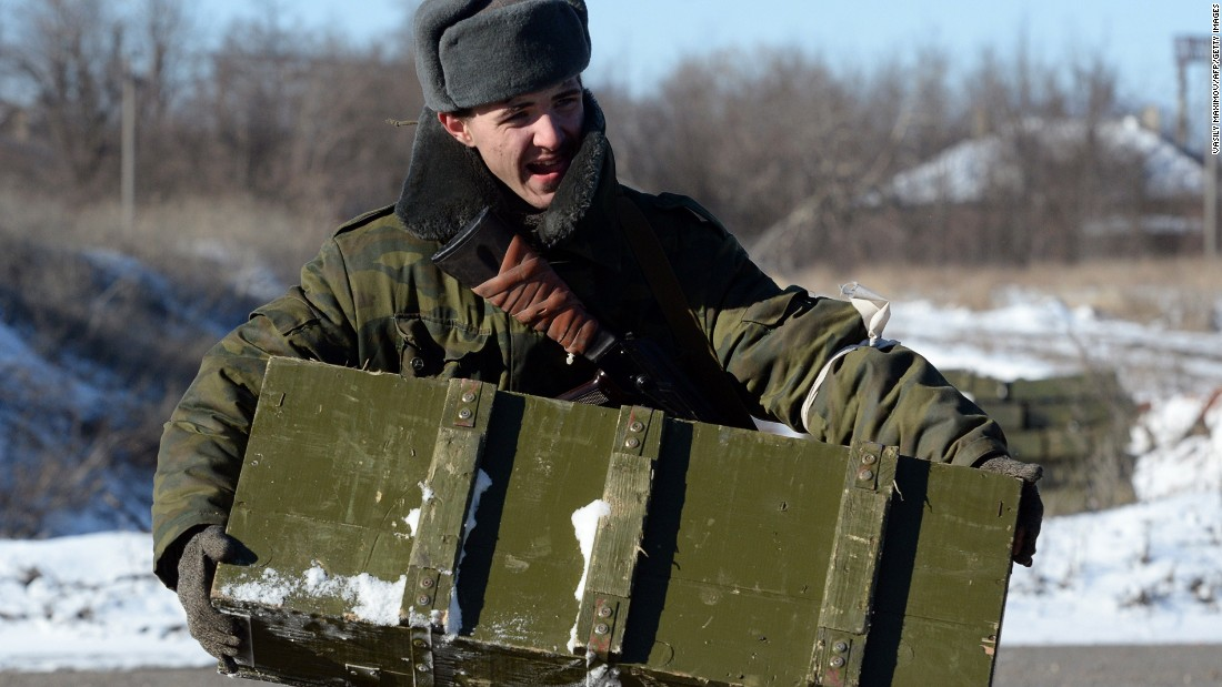 A pro-Russian rebel carries ammunition to be loaded onto a truck near Debaltseve on February 17.