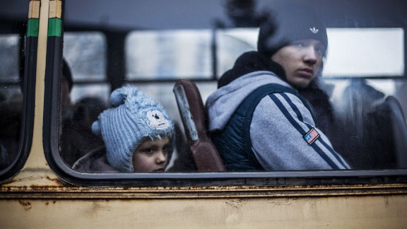 Ukrainian children sit in a bus before fleeing Debaltseve, in the Donetsk region, on February 3, 2015. Ukraine's military said Wednesday that 80% of Ukrainian armed forces have now pulled out of a strategic railroad hub that's been the focus of bitter fighting with pro-Russian separatists.