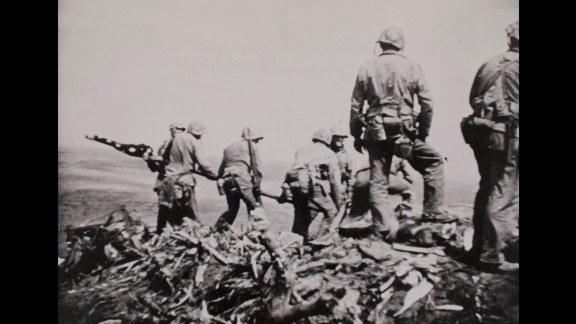 This image, from a 16mm film shot by Marine Sgt. William Genaust, shows Marines beginning to raise the second flag.