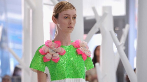 Josep Font, the creative director of DELPOZO, incorporated handcrafted fabric flowers on dresses for his artistic and colorful collection.