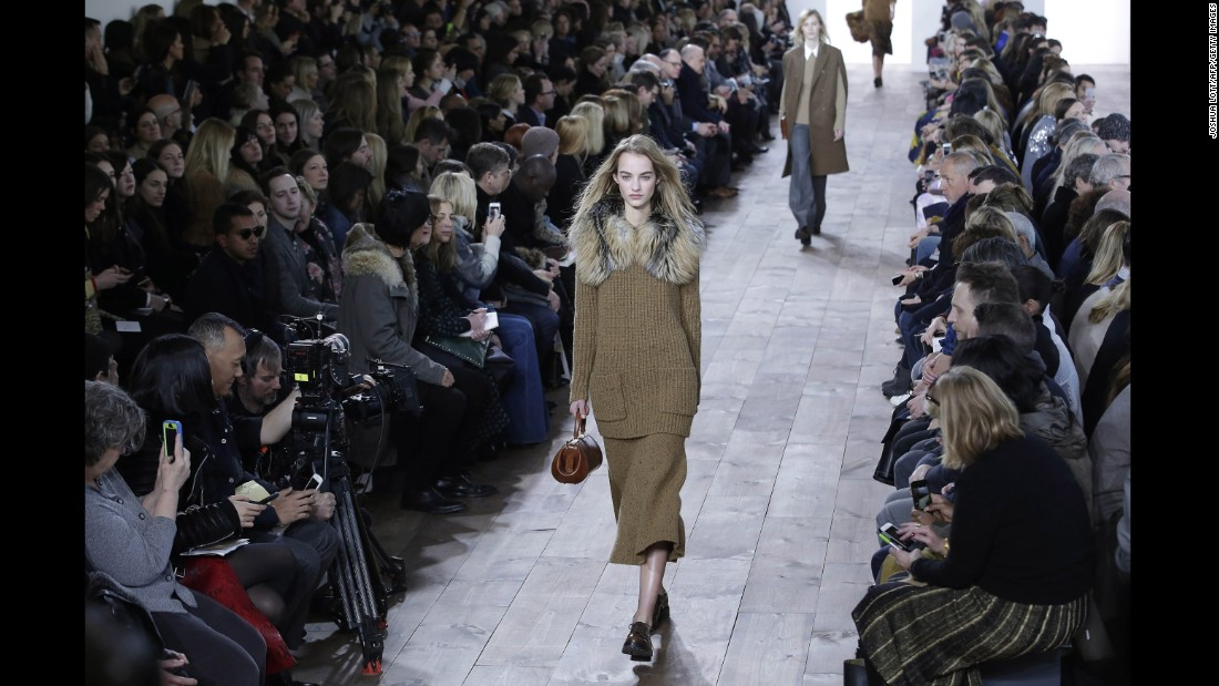 Michael Kors accented chunky knits with fur in one of the looks for his fall collection.