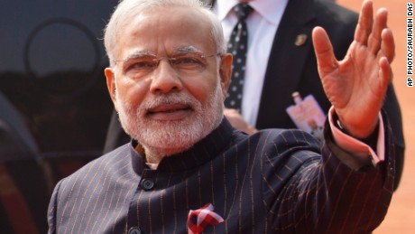 Indian Prime Minister Narendra Modi's dark pinstriped suit with his name monogrammed in gold stripes ignited social media.