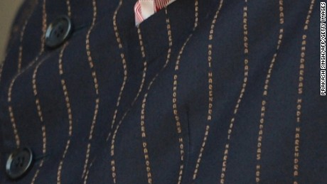 This close-up shows the details of the Indian Prime Minister Narendra Modi's suit bearing his own name.