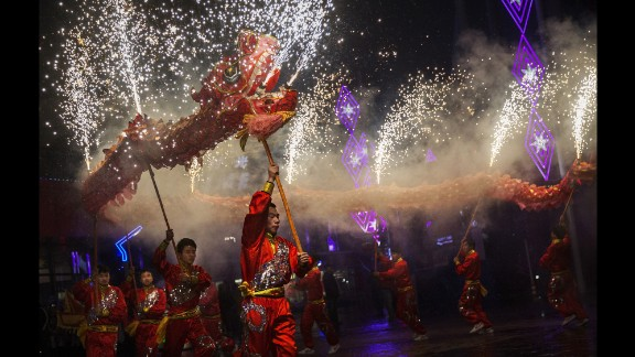 """Artists perform at an amusement park during Lunar New Year celebrations in Beijing on Thursday, February 19. The<a href=""""http://edition.cnn.com/2015/02/12/asia/year-of-the-goat-sheep-ram/index.html""""> Year of the Sheep</a> began that Thursday."""