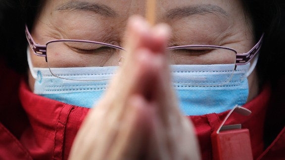 A woman prays in Beijing on February 19.